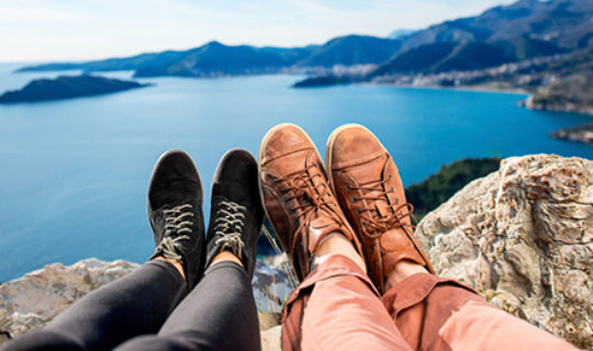 Two People Relaxing On A Mountain Top- Thumbnail