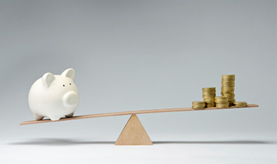 Piggy Bank And Coins Balancing- Thumbnail