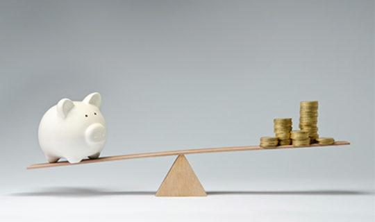 Piggy Bank And Coins Balancing- Thumbnail