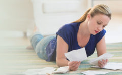 Woman Reviewing Personal Loan Documents- Thumbnail