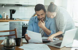 Man And Woman Planning To Consolidate Debt