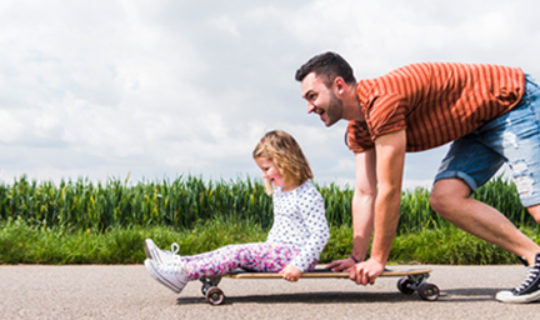 Man And Child On A Skateboard- Thumbnail