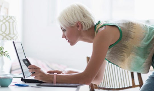 Woman Comparing Personal Loans Online- Thumbnail