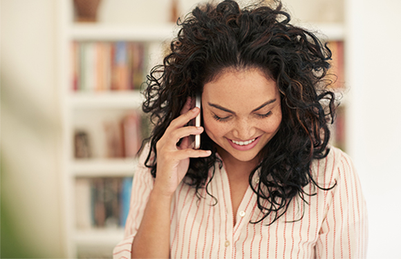Woman on Phone with Online Loan Provider