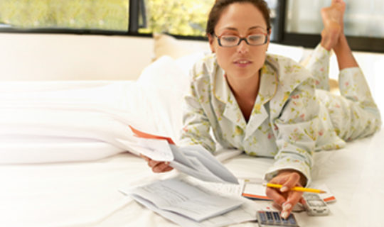 Woman Reading About Personal Loans Lenders- Thumbnail