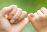 Two Hands Interlocked Showing Commitment- Thumbnail