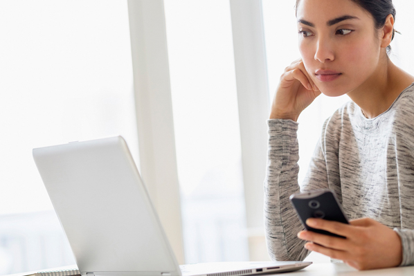 Woman Figuring Out How To Become Debt Free