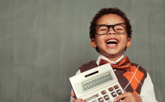 boy holds calculator - thumbnail