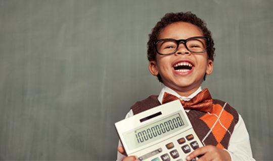 boy holds calculator - thumbnail