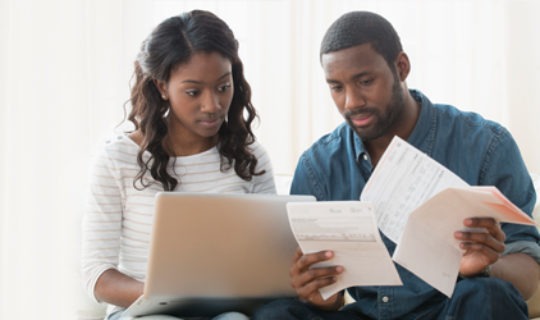 couple compares debt consolidation with refinancing - thumbnail