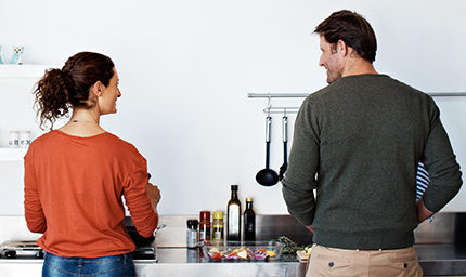 Man and woman cook in newly designed kitchen- thumbnail