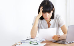 woman reviewing financial statements- thumbnail