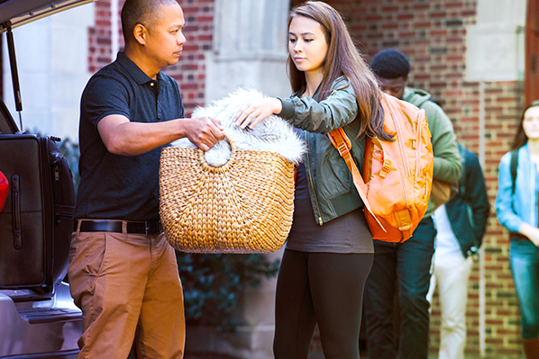 father helps pack up college kid