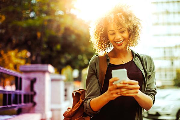woman checks loan options on her phone