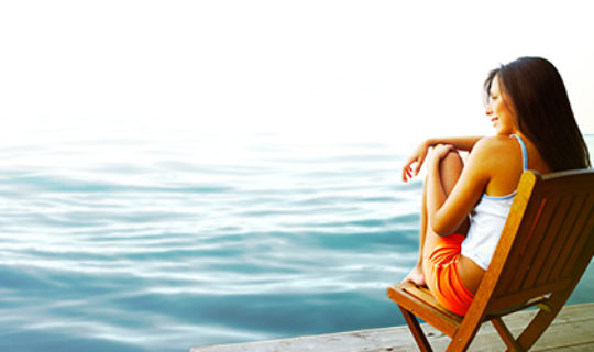 financially independent person sits by water