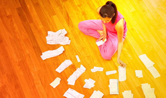 bills spread on floor