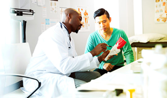 doctor reviewing health care spending with patient