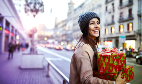 woman holding christmas gifts she just bought