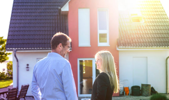 Couple admires new roof on their house