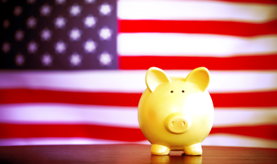 piggy bank and flag representing the costs of running for office