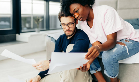 man and woman reviewing options before borrowing money