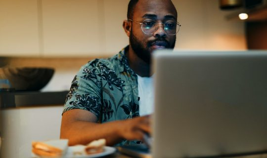 Man looking up online loan application options