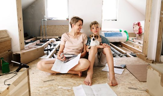 Mother and son think about remodeling project_Getty1169342321